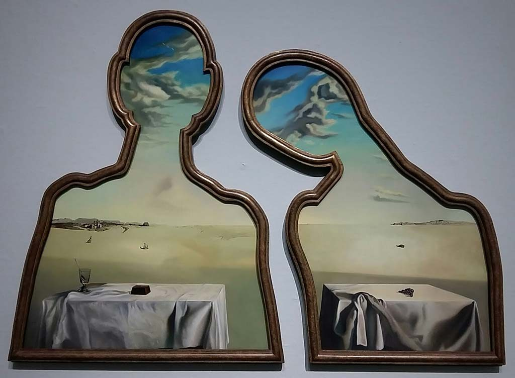 Gek van Surrealisme Koppel-met-hoofd-vol-wolken-©Dali-coll.-Edward-James-foto-Wilma-Lankhorst