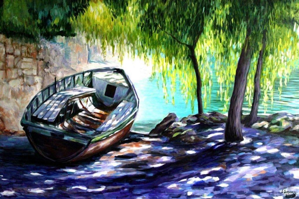Slavica Sekulokski boot op de oever van het meer © Slavica_Sekuloski